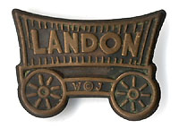 Alfred Landon: Scarce covered wagon lapel stud